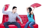 bigstock-Couple-Fight-On-Red-Sofa--Iso-50519015