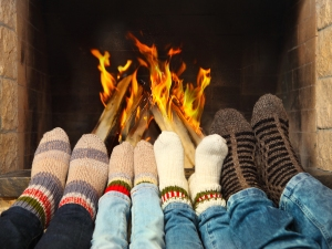 Feet Warming Near The Fireplace