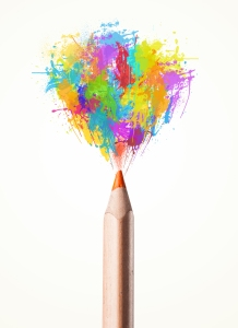 Colored pencil close-up with colored paint splashes
