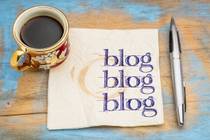 blog, blog, blog - blogging concept on a napkin with cup of espr